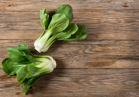 Top view of chinese cabbage (L. Brassica rapa) o Bok Choy on a rustic wooden background