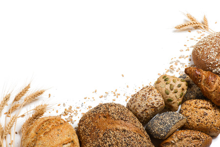 Top view of cereal bread, ears of wheat and different seeds isolated on white background.