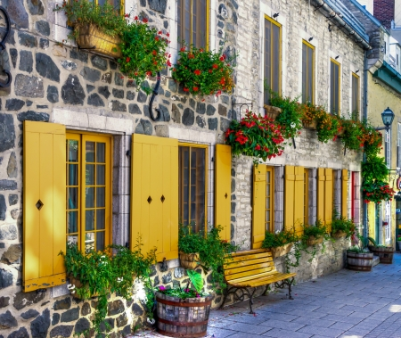 Street in a staging area with bench, flowerpot, typical of Old Quebec city. (HDR image)