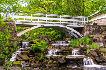 Small waterfall with a footbridge over the falls in Montreal,Quebec,Canada