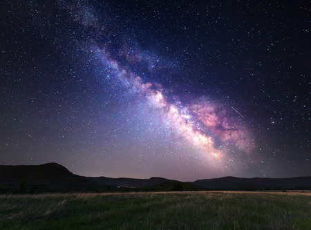 Landscape with Milky Way. Night sky with stars at mountains.