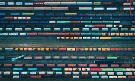 Photo pour Cargo trains close-up. Aerial view of colorful freight trains on the railway station. Wagons with goods on railroad. Heavy industry. Industrial conceptual scene with trains. Top view from flying drone - image libre de droit