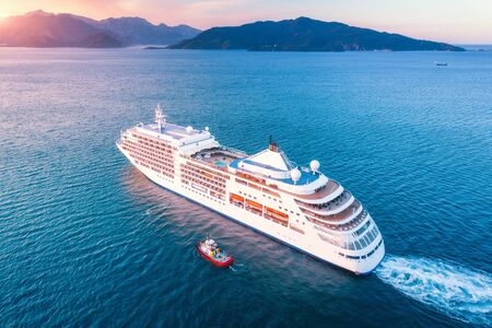 Photo for Cruise ship at harbor. Aerial view of beautiful large white ship at sunset. Colorful landscape with boats in marina bay, blue sea, sky. Top view from drone of yacht. Luxury cruise. Floating liner - Royalty Free Image