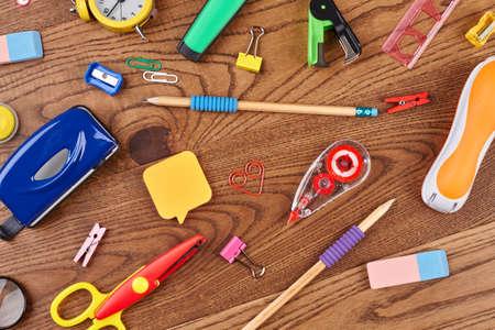 Photo pour School background with different supplies. Various students accessories on wooden background. Education concept. - image libre de droit