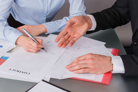 Photo pour Woman client putting signature on legal document. Female hand puts signature on business document making employment contract agreement. Investment or insurance deal after successful negotiation. - image libre de droit