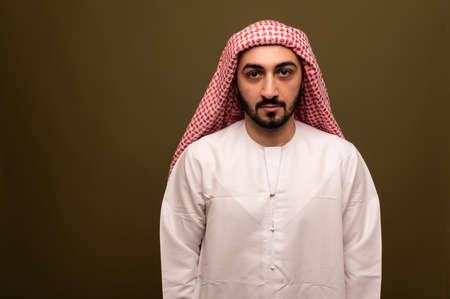 Photo pour Muslim man. Portrait of a young arab man in traditional dress. - image libre de droit