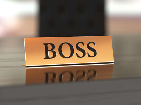 Foto de Golden nameplate with Boss text on the wooden table, with soft focus - Imagen libre de derechos