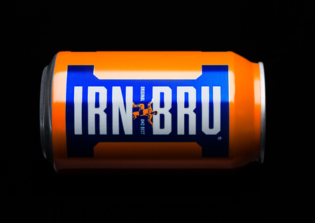 LONDON, UK - MARCH 15, 2017: Can of Irn-Bru lemonade soda drink on black background. Produced by Barr in Scotland, UK