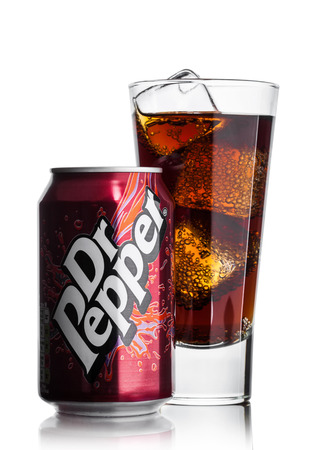 LONDON, UK - JUNE 9, 2017: Aluminium can of Dr.Pepper  with glass and ice cubes on white background.Created in the 1880s by Charles Alderton in Waco, Texas, USA