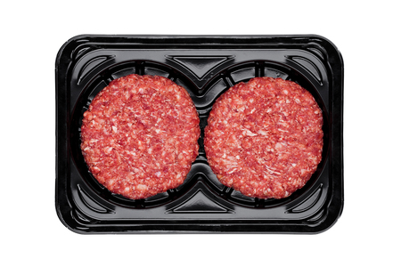 Raw fresh beef burgers in plastic tray on white background