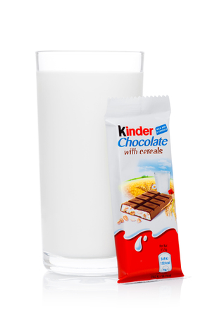 LONDON, UK - November 17, 2017: Kinder chocolate bar with cereals  and milk glass on white background.Kinder bars are produced by Ferrero founded in 1946.