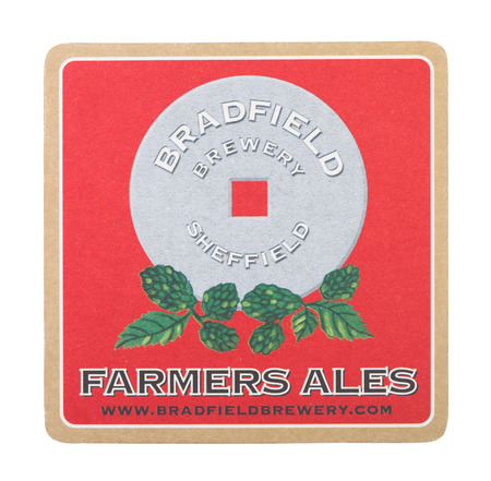 LONDON, UK - AUGUST 22, 2018: Bradfield brewery farmers ales paper beer beermat coaster isolated on white background.