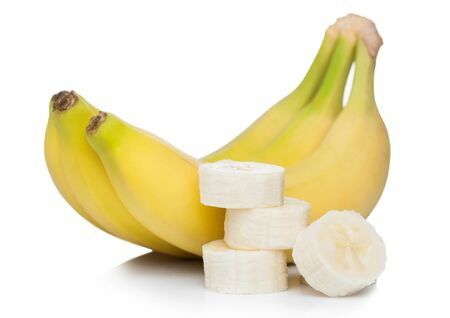 Photo for Fresh ripe organic bananas cluster with sliced pieces on white. - Royalty Free Image