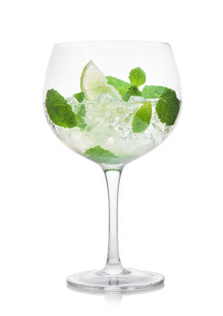Photo pour Glass of Mojito summer alcoholic cocktail with ice cubes mint and lime on white background. - image libre de droit