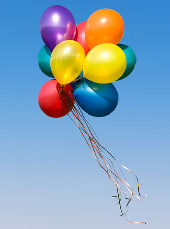 Bunch of colorful balloons in blue sky