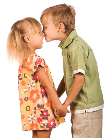 Little boy with girl isolated on white background. Friendly kiss.