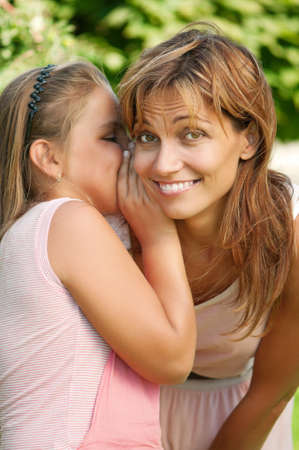 Happy mother with her daughter in park outdoors