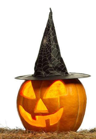 Foto de Funny Halloween pumpkin with black hat glowing on white background - Imagen libre de derechos