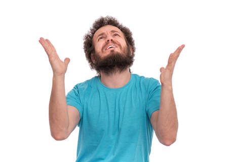 Photo for Portrait of caucasian crazy bearded Man with funny Curly Hair - saying prayers, isolated on white background. Religious image - Guy praying and praising God. - Royalty Free Image