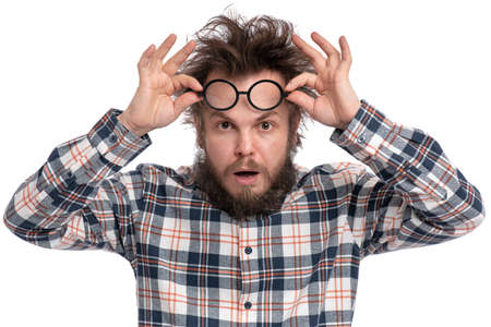 Photo pour Crazy bearded Man with funny Haircut in Eyeglasses, isolated on white background. Surprised or Shocked guy in plaid shirt, keeping mouth open. Emotions and signs concept. - image libre de droit