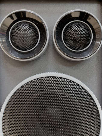 Photo pour Close-up of musical stereo speaker with protective grill. Modern grey and black audio speaker or music column for background. - image libre de droit