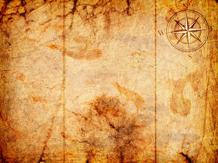 Foto de old map with a compass on it on a grunge background - Imagen libre de derechos