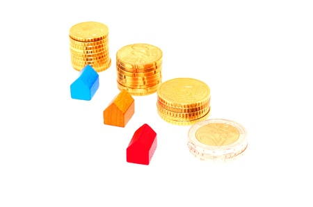 Miniature houses and euro coins