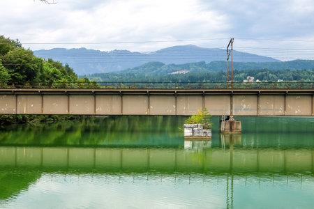 Villach, Austria - Augusth, 19th, 2017. View of railway bridge over the river Drau