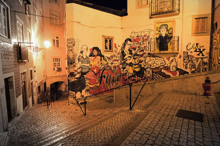 Typical urban scene in the narrow streets of Lisbon, Portugal, at night
