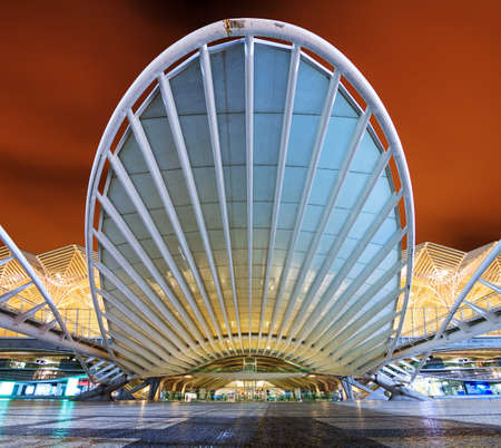 The beautiful modern entrance to the Orient station at night in Lisbon, Portugal