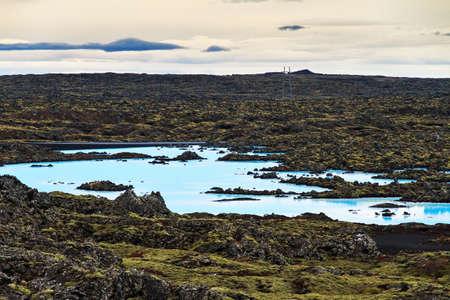 Blue lagoon waters in the lava field landscape of Iceland in winter