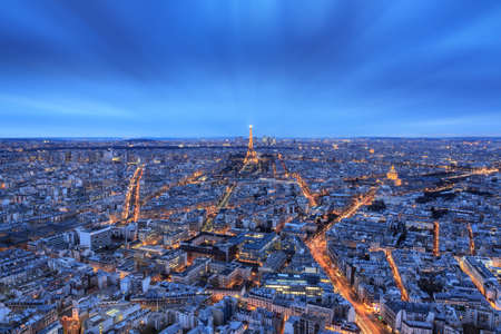 Photo pour Beautiful aerial skyline cityscape of Paris, France, after sunset in the blue hour, with the Eiffel tower, seen from the Montparnasse skyscraper - image libre de droit