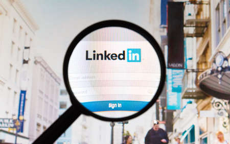 Photo pour Montreal, Canada - February 2016 - LinkedIn website picture taken under a magnifying glass. Linkedin is a professional and business-oriented social networking service. - image libre de droit