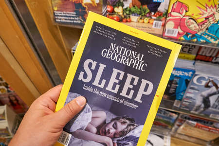 MIAMI, USA - AUGUST 22, 2018: National Geographics magazine in a hand. National Geographic is the official magazine of the National Geographic Society.