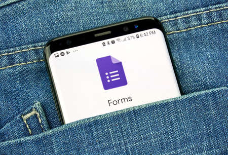MONTREAL, CANADA - OCTOBER 4, 2018: Google Forms app on s8 screen in a pocket of a blue jeans. Google is an American technology company which provides a variety of internet services.