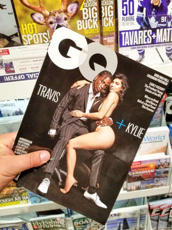 TORONTO, CANADA - DECEMBER 9, 2018: Travis Scott and Kylie Jenner on a cover page of GQ magazine. GQ is an international monthly men's magazine.