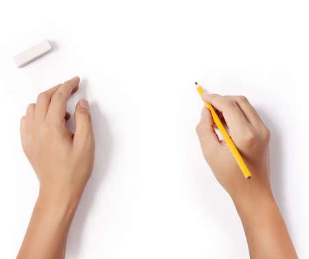 Foto de hands with pencil and erase rubber writting something  - Imagen libre de derechos
