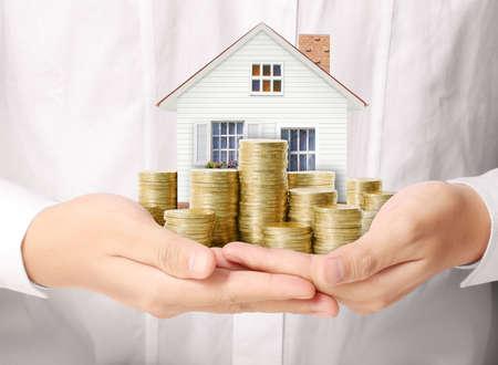 Photo pour Mortgage concept by money house from the coins - image libre de droit