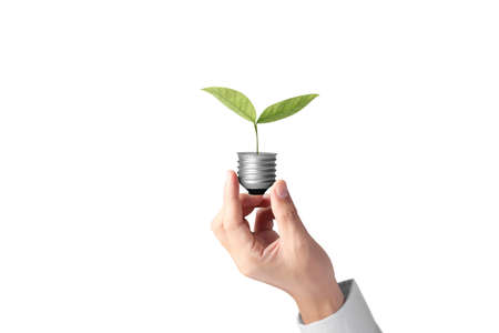 Foto de hand holding a light bulb with energy  - Imagen libre de derechos