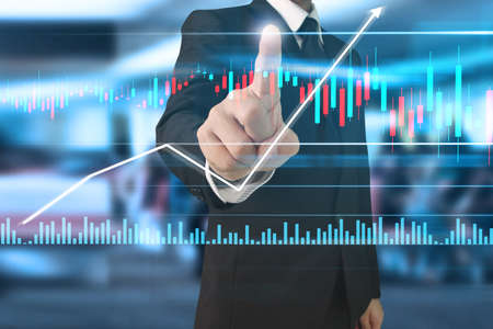 Foto de Businessman plan graph growth and increase of chart positive indicators in his business - Imagen libre de derechos