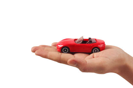 Photo for Red toy car in hand Protecting the security concept - Royalty Free Image