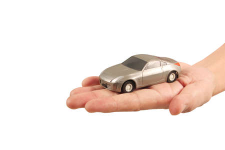 Photo pour Toy car in hand Protecting the security concept - image libre de droit