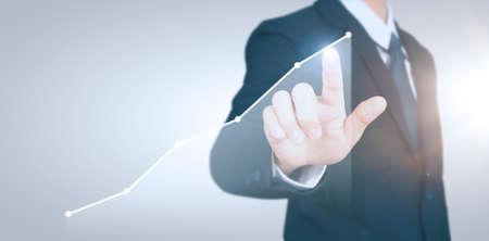 Photo pour Businessman plan graph growth and increase of chart positive indicators in his business - image libre de droit