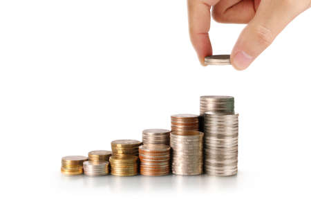 Photo pour Pile of Coins on stacks and hand. investment  saving concept - image libre de droit