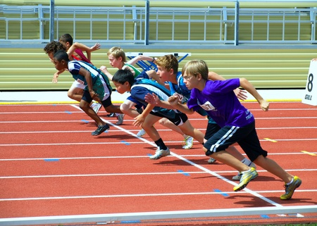 Photo for KAMLOOPS, CANADA-JULY 23:unidentified boys on the start of the 100 meters dash on the BC Junior Development Track and Field Championships July 23, 2011 in Kamloops , Canada - Royalty Free Image