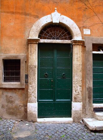 Exterior of the typical old door in Rome, Italy.