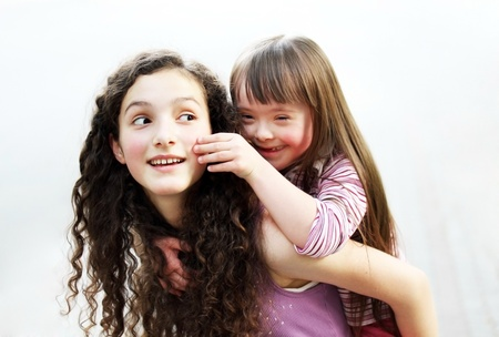Happy little girl with sister