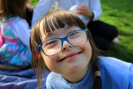 Photo for Portrait of little girl smiling outside - Royalty Free Image