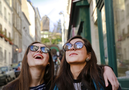 Photo for Happy beautiful student girls in Paris on the street - Royalty Free Image