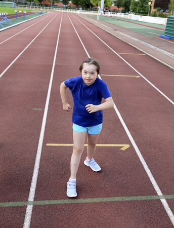 Foto per Little girl have fun on the stadium - Immagine Royalty Free
